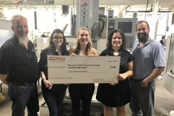 AMP it up! Challenge winners Blackstone Valley Regional Vocational Technical High School with MassDevelopment Project Manager of Manufacturing Initiatives Larissa Matzek (second from right)